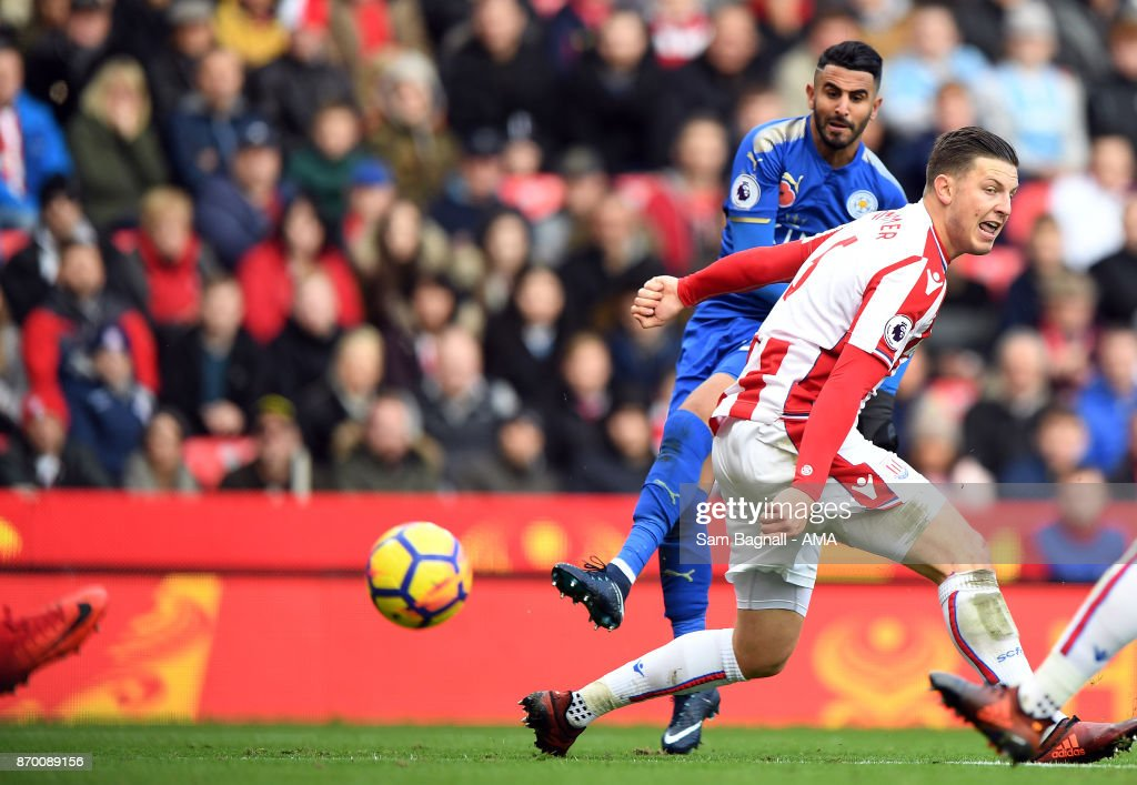 Riyad Mahrez of Leicester City scores a goal to make it 1-2 during the Premier League match between Stoke City and Leicester City at Bet365 Stadium on November 4, 2017 in Stoke on Trent, England.