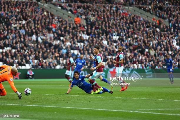 Riyad Mahrez of Leicester City scores his sides first goal during the Premier League match between West Ham United and Leicester City at London...