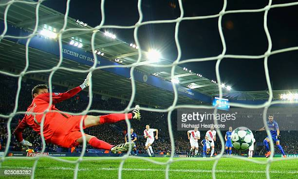 Riyad Mahrez of Leicester City scores his sides second goal from the penalty spot during the UEFA Champions League match between Leicester City FC...