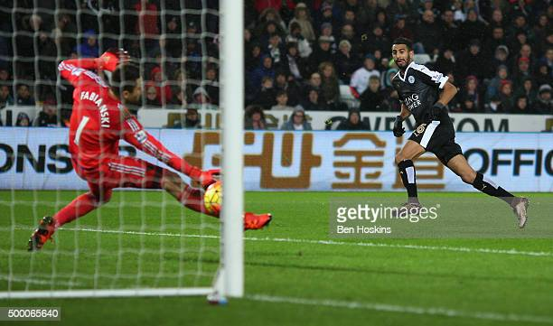 Riyad Mahrez of Leicester City scores his team's third and hat trick goal during the Barclays Premier League match between Swansea City and Leicester...