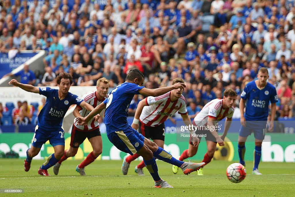 Riyad Mahrez of Leicester City scores his team's third goal from the penalty spot during the Barclays Premier League match between Leicester City and...