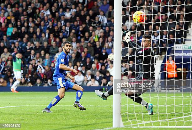 Riyad Mahrez of Leicester City scores past Boaz Myhill of West Brom to make it 12 during the Premier League match between West Bromwich Albion and...