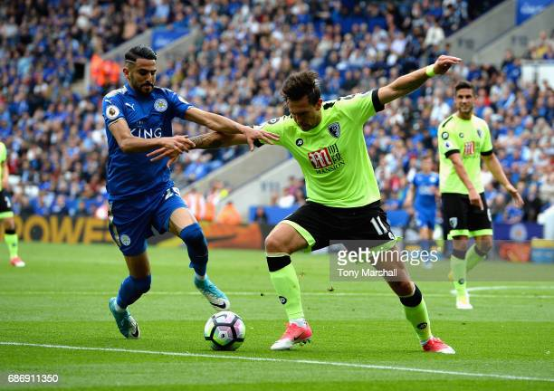 Riyad Mahrez of Leicester City tackles Charlie Daniels of AFC Bournemouth during the Premier League match between Leicester City and AFC Bournemouth...