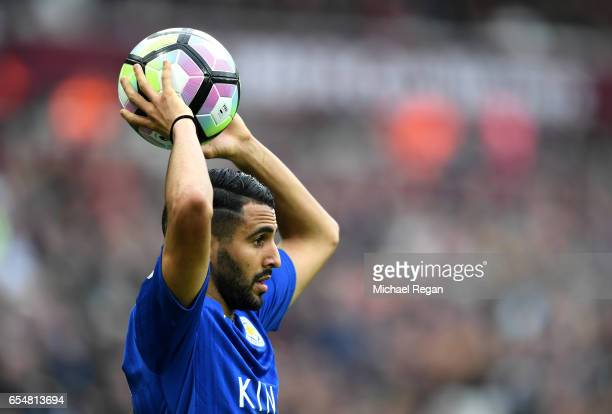 Riyad Mahrez of Leicester City takes a throw in during the Premier League match between West Ham United and Leicester City at London Stadium on March...