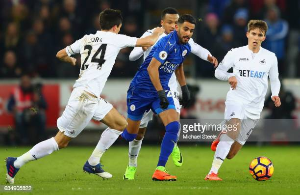 Riyad Mahrez of Leicester City takes on Jack Cork Martin Olsson and Tom Carroll of Swansea City during the Premier League match between Swansea City...