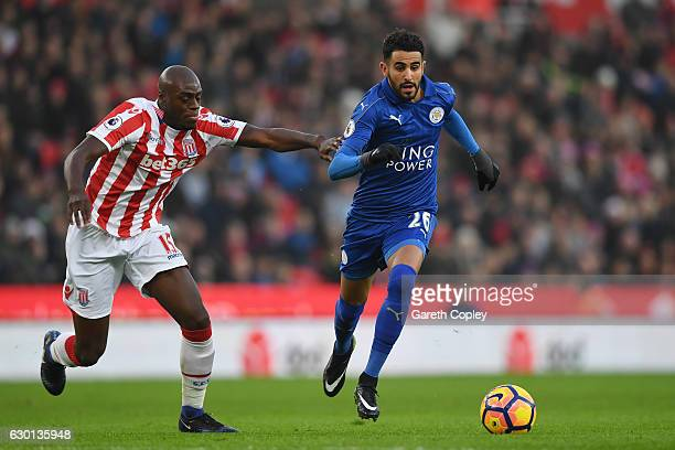 Riyad Mahrez of Leicester City takes the ball past Bruno Martins Indi of Stoke City during the Premier League match between Stoke City and Leicester...