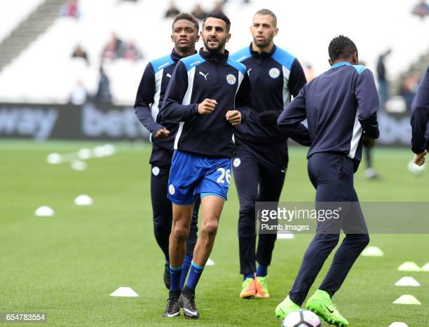 Riyad Mahrez of Leicester City warms up at London Stadium ahead of the Premier League match between West Ham and Leicester City at London Stadium on...