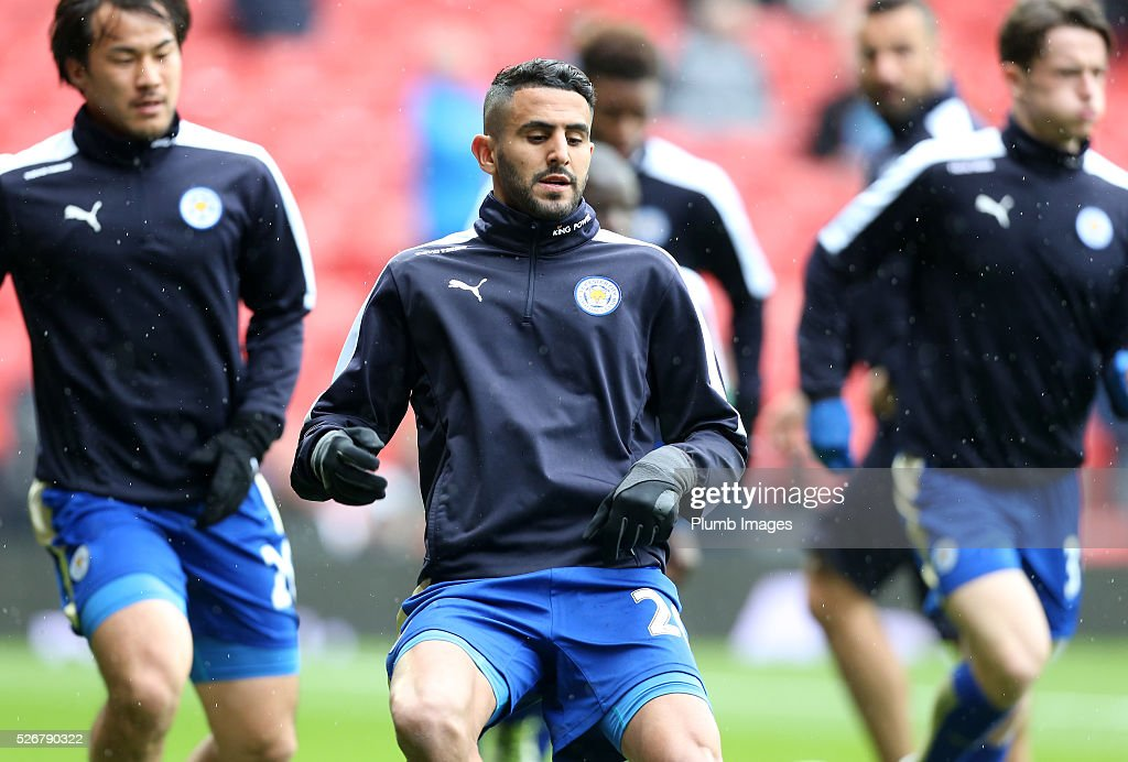 <a gi-track='captionPersonalityLinkClicked' href=/galleries/search?phrase=Riyad+Mahrez&family=editorial&specificpeople=9166027 ng-click='$event.stopPropagation()'>Riyad Mahrez</a> of Leicester City warms up at Old Trafford ahead of the Premier League match between Manchester United and Leicester City at Old Trafford on May 01, 2016 in Manchester, United Kingdom.