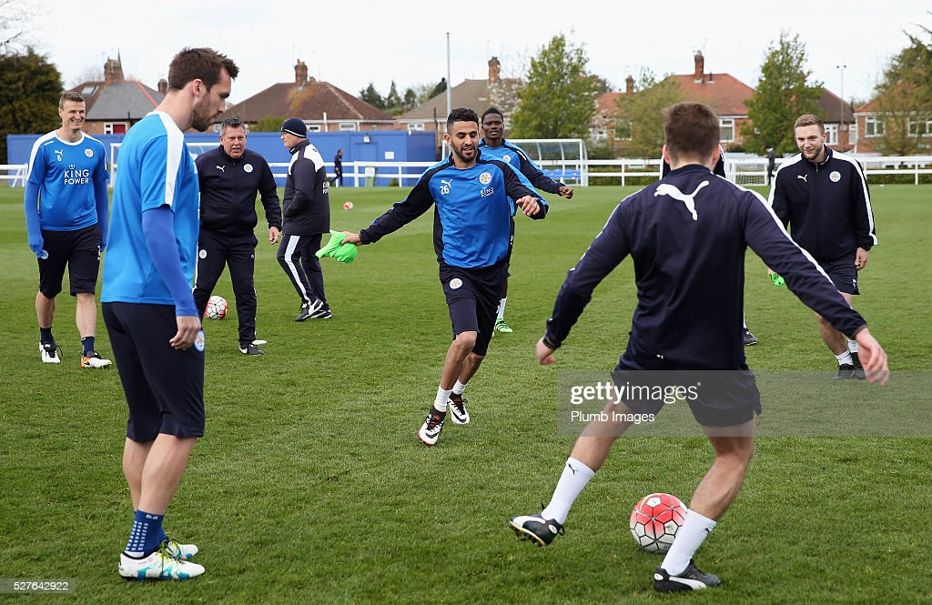 Riyad Mahrez of Leicester City warms up with team mates during a Leicester City training session at Belvoir Drive Training Ground on May 3, 2016 in Leicester, England.
