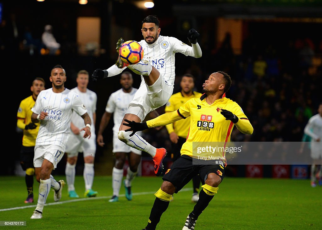 Riyad Mahrez of Leicester City wins the ball in the air from Camilo Zuniga of Watford during the Premier League match between Watford and Leicester City at Vicarage Road on November 19, 2016 in Watford, England.