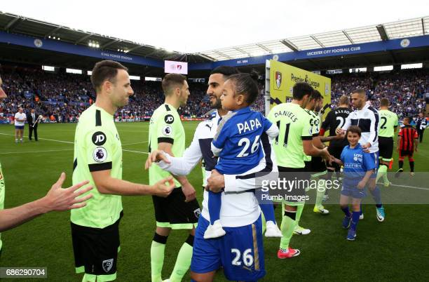 Riyad Mahrez of Leicester City with his daughter at King Power Stadium ahead of the Premier League match between Leicester City and Bournemouth at...