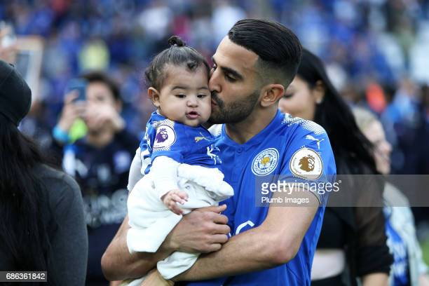 Riyad Mahrez of Leicester City with his young daughter after the Premier League match between Leicester City and Bournemouth at King Power Stadium on...
