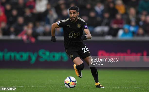 Riyad Mahrez of Leicester in action during the Premier League match between Swansea City and Leicester City at Liberty Stadium on October 21 2017 in...