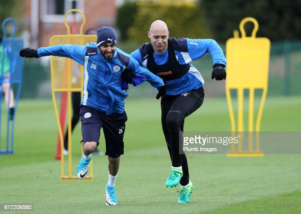 Riyad Mahrez races Yohan Benelouane during the Leicester City training session at Belvoir Drive Training Complex on April 24 2017 in Leicester United...