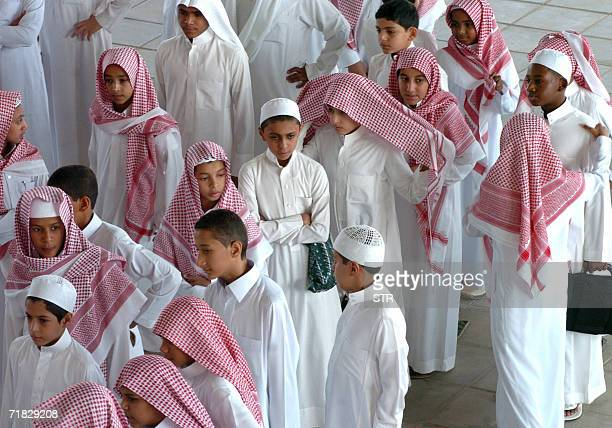 Saudi boys stand in line on their first day back to school in Riyadh 09 September 2006 Five years after the September 11 attacks US accusations...