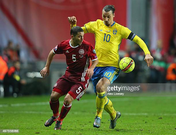 Riza Durmisi of Denmark and Zlatan Ibrahimovic of Sweden compete for the ball during the UEFA EURO 2016 Qualifier PlayOff Second Leg match between...
