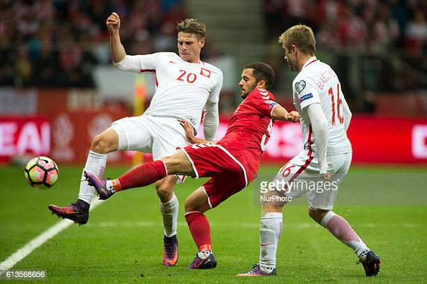 Riza Durmisi of Denmark fights for the ball with Jakub Blaszczykowski and Lukasz Piszczek of Poland during the FIFA World Cup 2018 Qualifying Group E...