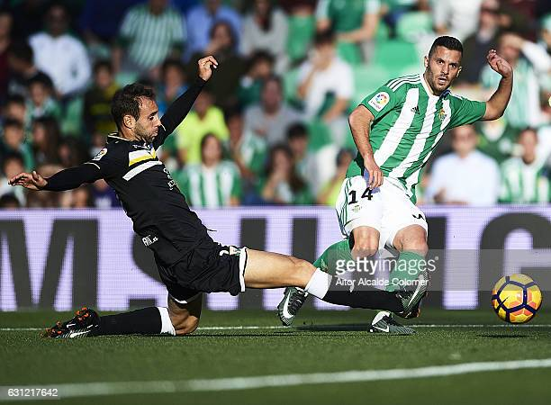 Riza Durmisi of Real Betis Balompie and Victor Diaz of CD Leganes in action during La Liga match between Real Betis Balompie v CD Leganes at Benito...