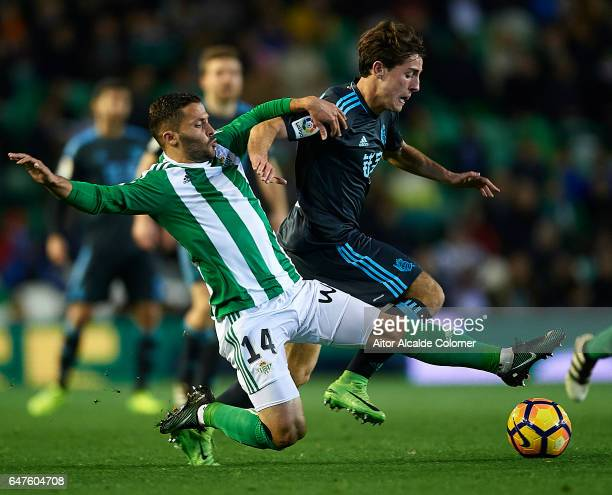 Riza Durmisi of Real Betis Balompie competes for the ball with Alvaro Odriozola of Real Sociedad during La Liga match between Real Betis Balompie and...