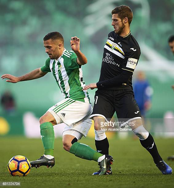 Riza Durmisi of Real Betis Balompie competes for the ball with Ruben Perez of CD Leganes during La Liga match between Real Betis Balompie v CD...