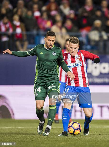 Riza Durmisi of Real Betis Balompie fights for the ball with Kevin Gameiro of Atletico de Madrid during their La Liga 201617 match between Atletico...