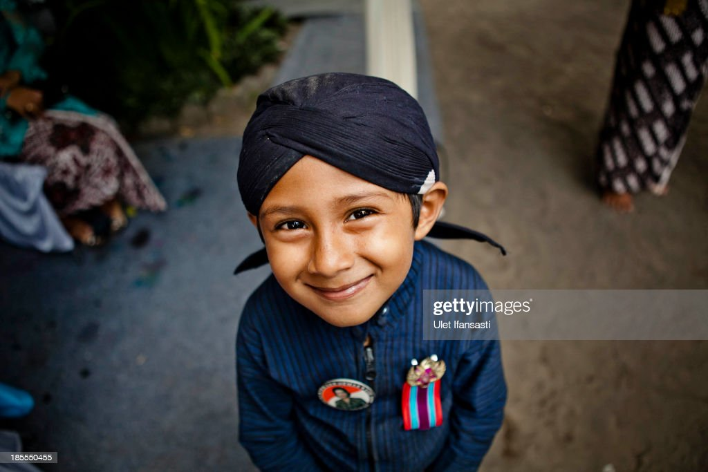 Rizki (5), volunteer of Kraton Palace, known as 'Abdi Dalem', attends the Royal Wedding Held For Sultan Hamengkubuwono X's Daughter Gusti Ratu Kanjeng Hayu And KPH Notonegoro on October 22, 2013 in Yogyakarta, Indonesia. Wedding celebrations will take place October 21-23 October. The wedding parade will include 12 royal horse drawn carriages and will be streamed live on the internet so that it can be watched by people all over the world.