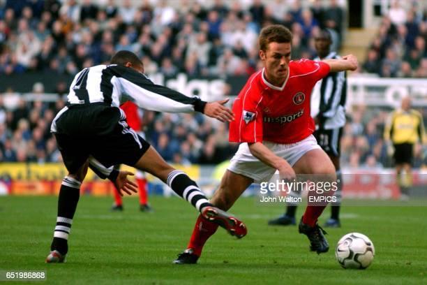 rl Charlton Athletic's Scott Parker escapes the challenge of Newcastle United's Jermaine Jenas