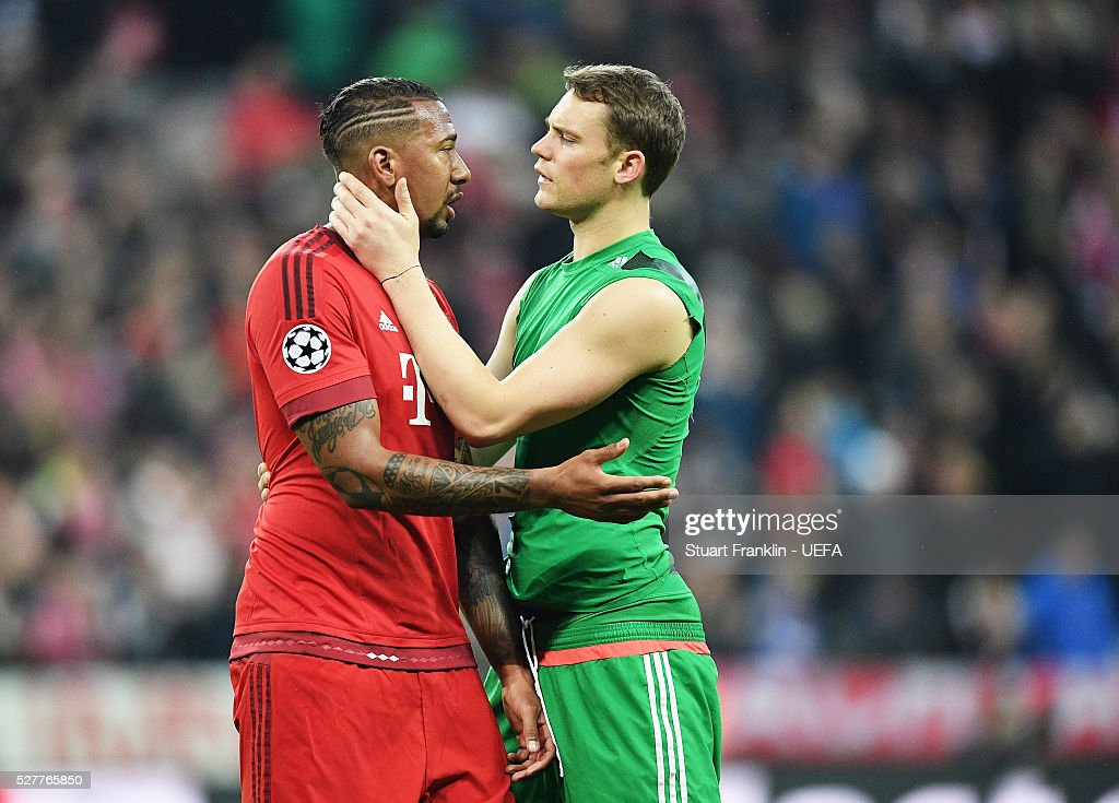 J��r��me Boateng of Muenchen is comforted by Manuel Neuer after the UEFA Champions League Semi Final second leg match between FC Bayern Muenchen and Club Atletico de Madrid at the Allianz Arena on May 03, 2016 in Munich, Bavaria.