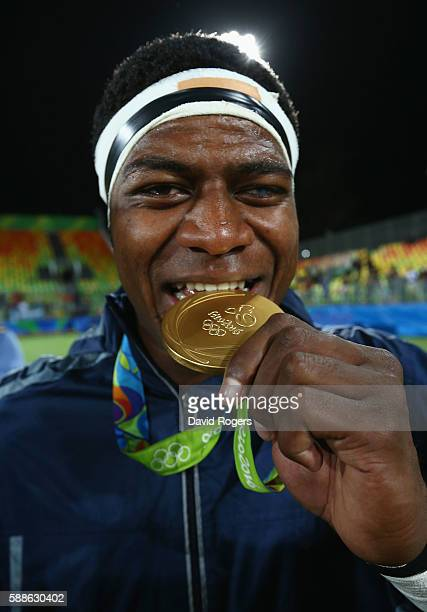 Ro Dakuwaqa of Fiji celebrates with his gold medal after the medal ceremony for the Men's Rugby Sevens on Day 6 of the Rio 2016 Olympics at Deodoro...