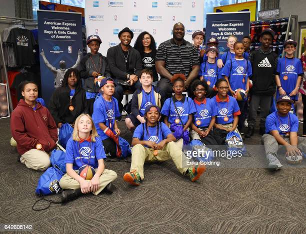 Ro Parrish and Shaquille O'Neal pose with the Boys Girls Club of Southeast Louisiana with American Express at the NBA Store for NBA AllStar on...