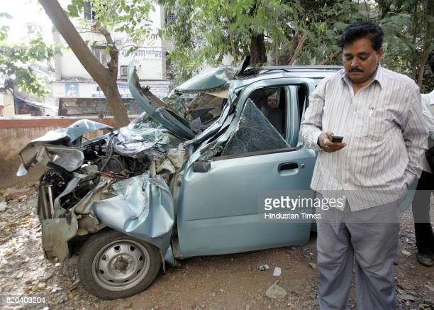Road Accidents A shaken Harishankar Sharma stands near his smashed WagonR on Wednesday The front of the Navi Mumbai residents car was destroyed when...