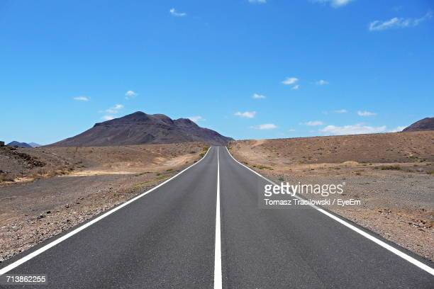 Road Amidst Desert Against Sky