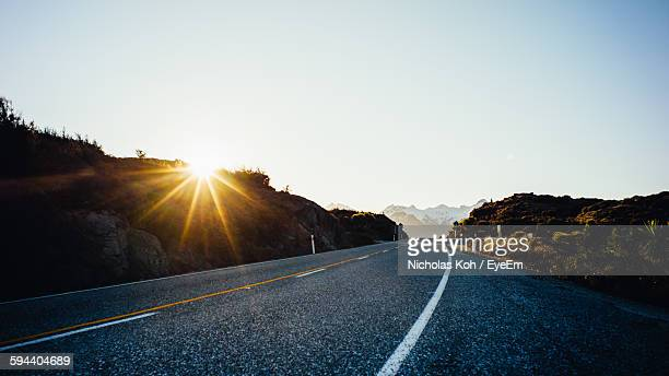 Road Amidst Hills Against Clear Sky