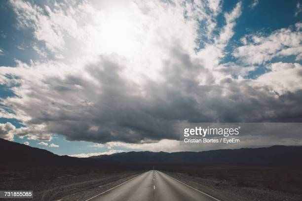 Road Amidst Landscape Against Sky