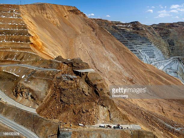 A road and mining equipment damaged from the Bingham Canyon copper mine wall slide are seen in this aerial photograph taken in Bingham Utah US on...