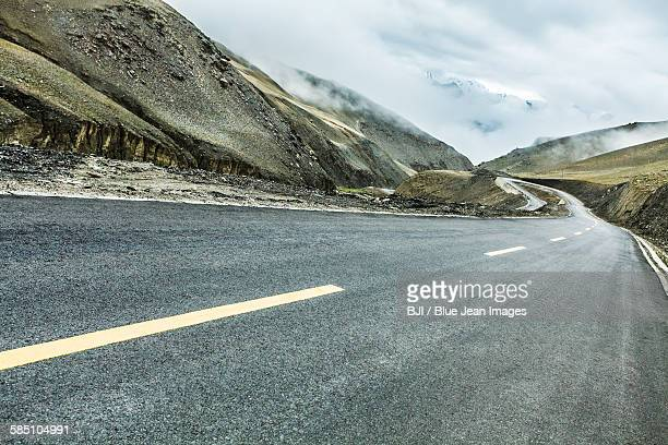 Road and mountains in Tibet, China