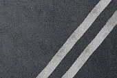 Road asphalt texture with separation lines. Background.