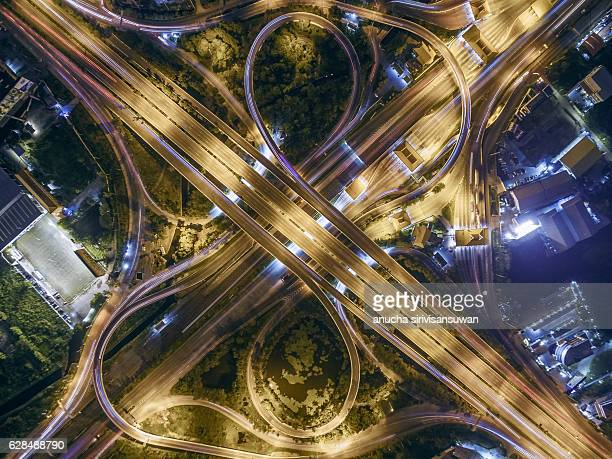 Road beautiful Aerial View of Busy Intersection at Night .