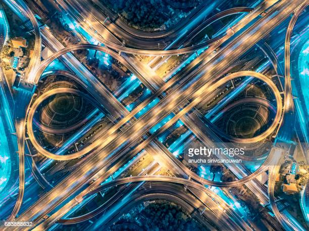 Road beautiful Aerial View of Busy Intersection at Night , top view , thailand .