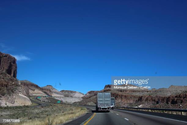 Road By Mountain Against Clear Blue Sky