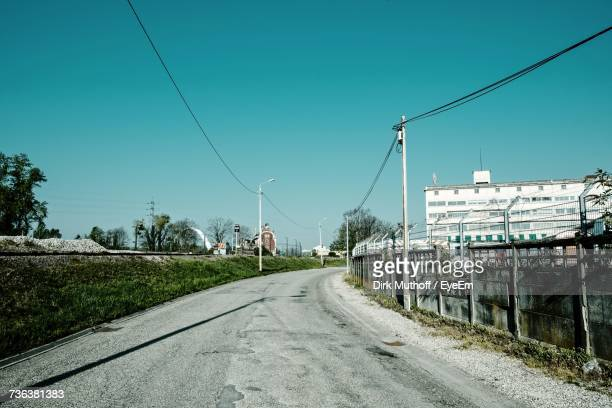 Road By Railroad Tracks Against Clear Sky