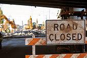 Worn Road Closed barricade blocks road at Atlanta collapsed interstate bridge construction site.