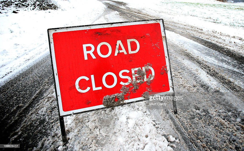 A road closed sign remains in place on a untreated road on January 21, 2013 near Bath, England. As the UK's cold snap continues, parts of the country including the South West and Wales were bracing themselves for even more snow, forecast to arrive tonight and tomorrow.