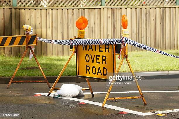 A road closure sign sits at Narrabeen Lake on April 22 2015 in Sydney Australia Three people have died and more than 200000 are still without power...