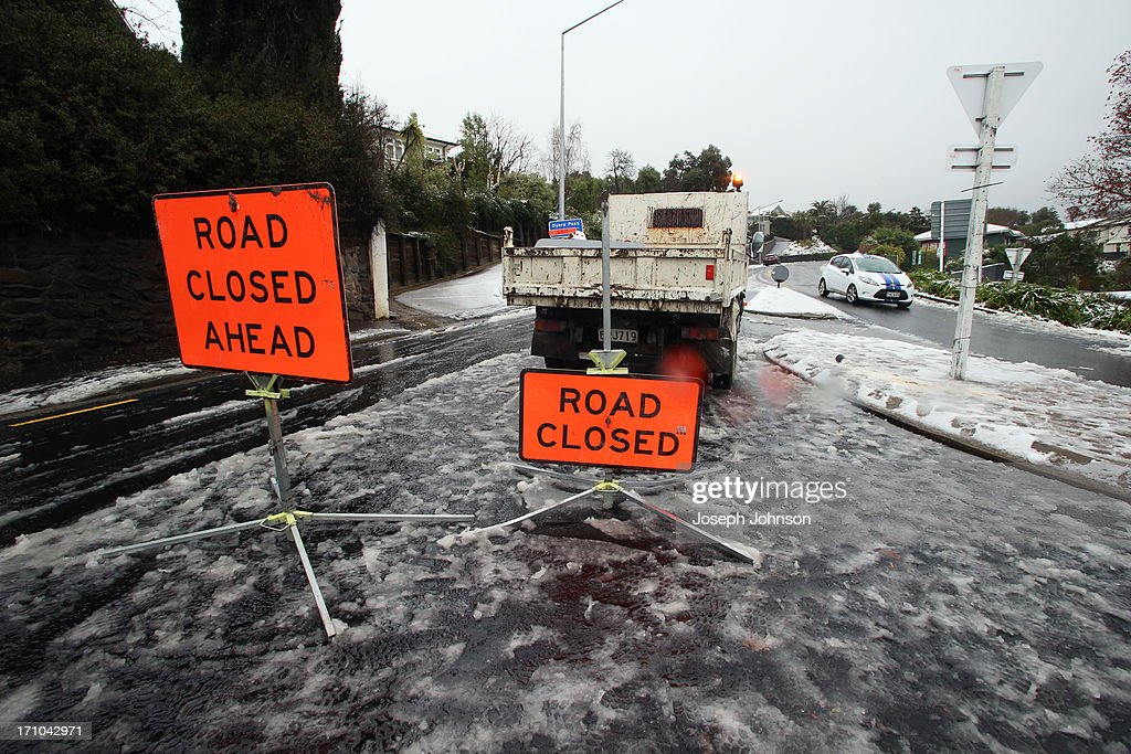 Road closures at the bottom of Dyers Pass Road, Port Hills, on June 21, 2013 in Christchurch, New Zealand. Now, sleet, rain and heavy winds have hit the region causing power outages, some flooding and bringing trees down.