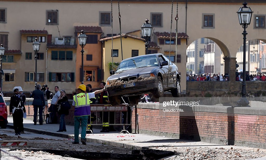 Road collapses in Florence on May 25, 2016 in Florence, Italy. The deterioration of one or more water pipe opened a 200 m wide and 7m deep long hole on Wednesday morning along the Arno river bank near to the famous Ponte Vecchio bridge.