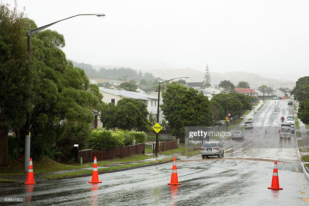 Road cones close a portion of Mungavin Avenue after heavy rain caused flooding on May 5, 2016 in Porirua, New Zealand. Severe rain warnings have been issued for the bottom of the North Island, and and several schools and parts of the city have been closed due to surface floosing