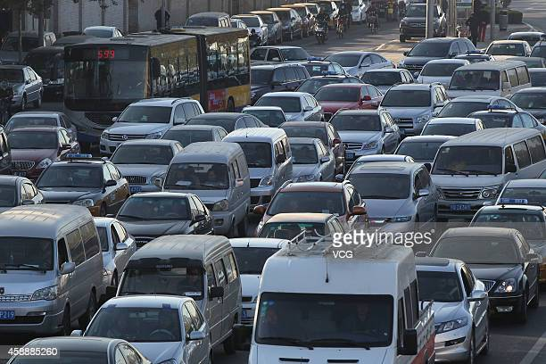 Road congestion appears after termination of oddeven traffic ban on November 13 2014 in Beijing China Traffic ban of oddeven license plates were...