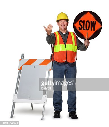 Road construction worker holding slow sign on white background