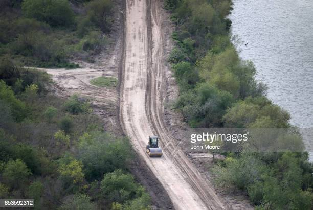 A road crew improves a road along the USMexico border on March 15 2017 in Hidalgo Texas There has been great speculation on exactly where a border...